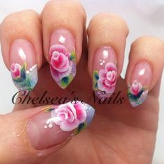 Wow! Impressive! Soft pink and white roses on pointed nails.