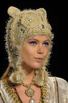 This Anna Sui designer crochet hat includes some novelty yarn, source: http://cruisecontrolforcool.tumblr.com/post/17810266792/english-rose-frida-gustavsson-at-anna-sui-fall