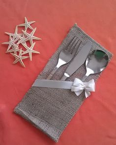 """Burlap silverware holders perfect for your rustic wedding or home decor!  This listing is for one burlap silverware holder sample which is decorated with ivory ribbon with bow.  Dimension : 4' x 8""""  If you require different quantities - please contact us and we will be happy to make a custom listing for you!"""