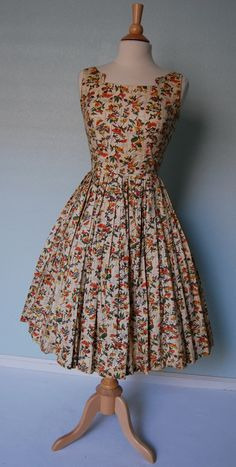 A charming floral cocktail dress from the 1950s.