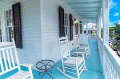 Relax on your front porch with a cool drink at The Grand Marshall House in Key West. Historic and stately, this 2-story home will turn your winter into an endless summer. #historic #charming #keywestflorida #florida #frontporch #teal #rockingchair #gingergread #islandstyle Victorian Cottage, 2 Story Houses, Cottage Style Homes, Fun Drinks, Key West, Rocking Chair, Front Porch, Porches, Gingerbread