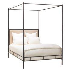 Hand-hammered Iron bed frame with tapered posts and upholstered headboard.