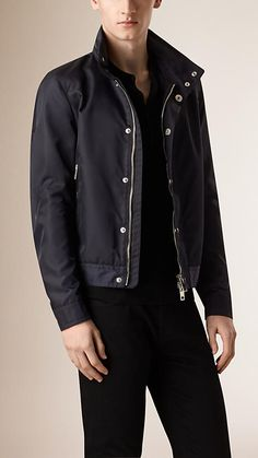 Burberry Navy Technical Packaway Hood Blouson - A zip-through blouson constructed in a technical fabric. The fitted design features a packaway hood with zip closure and zip pockets at the waist.  Discover the men's outerwear collection at Burberry.com