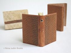 """One of three miniature books """"Tolkien's Gollum"""", this one is  bound in calf leather and fish leather, with a fish leather jacket and a parchment case"""