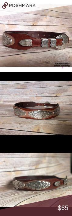"""Vintage Italian Leather Belt Absolutely gorgeous vintage belt made from genuine Italian leather. There are five silver decorative plates each with ornately designed floral and filigree details. Buckle is also silver and mimics the floral designs around the belt. Belt is a beautiful brown leather with a lighter mocha brown overlay which the silver plates sit upon. Entire length of belt is 36.5"""" and is adjustable from 29""""-33"""". Perfect for your boho hippie chic outfits or your next music…"""