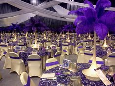 """36"""" lighted stands with purple feathers..For more information on this look, visit www.fancyfaces.com"""