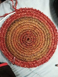 Crochet Around Clothesline Rope To Make A Rug Or Hot Pads. Click On Link,
