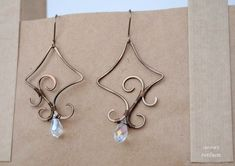 Wire wrapped free form earrings by IanirasArtifacts