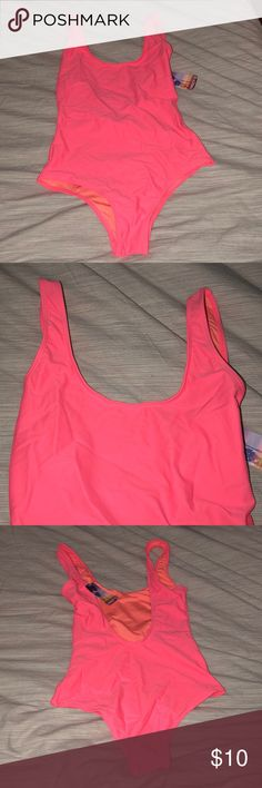 One piece bathing suit Brand new never worn forever 21 bathing suit. Color is more coral-like then it's photographing. Back is open and goes low cut! Forever 21 Swim One Pieces