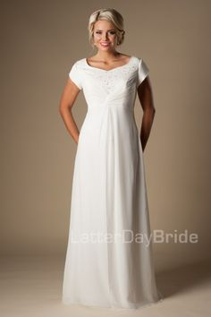 The Anderson | This classic modest wedding dress features a delicately beaded bodice and flattering ruching completed by an empire waistline and soft chiffon skirt.     Gown available in Ivory/Silver or White/Silver    *Gown pictured in Ivory/Silver    Available at LatterDayBride.com or in Store Located in Salt Lake City, Utah