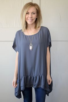 Livi Short Sleeve Ruffle Top - Charcoal When something so perfect comes into your life, you must buy it in every color, right? This flowy, ruffle top is it! Cap sleeves and side slits make it that much more comfortable. It's an easy shape for any body type and looks gorgeous with jeans or leggings! Long enough to cover the bum! #page6boutique #flirty #fabulous #charcoalgrey #casualtop