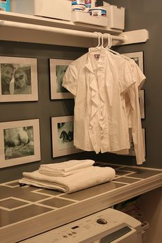 great idea to integrate a clothes rod in with the shelving for hanging clothes to dry!