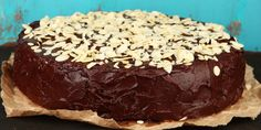 Tasty chocolate cake with almond, on old wooden table