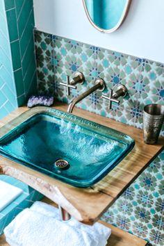 Turquoise bathroom glass sink wood frame