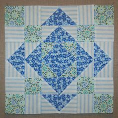:Could be a cute and easy baby quilt pattern if you used 5 or 6 inch squares.  You could fussy cut something cute for the center block: [Ferris Wheel block]