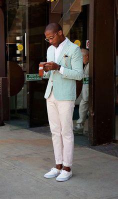 Shop this look on Lookastic:  https://lookastic.com/men/looks/blazer-long-sleeve-shirt-chinos-plimsolls-watch/10641  — White Long Sleeve Shirt  — Mint Blazer  — Black Leather Watch  — Pink Chinos  — White Plimsolls