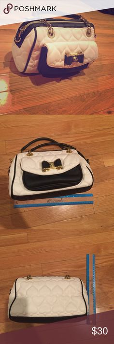 Betsey Johnson small handbag Small bag. 10x6x5. Front pocket with bow and magnetic button. Two 5 inch handles. Top zipper. Minor wear. Small scratch on front and scuff on back Betsey Johnson Bags Mini Bags