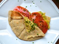 Fresh, bright tomatoes, slow-scrambled eggs, and delicate pita combine for a delightfully satisfying start to your day.