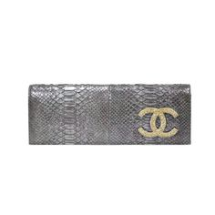 This Chanel clutch is crafted from a metallic purple python features a gold tone crystal embedded 'CC' logo and button snap closure in silver-toned metal hardware.The interior is lined with an olive green leather and features slip pocket, | Measurements: 28cm (length) x 10cm (height) x 5cm (depth) | Comes with original dust bag, authenticity card and care card.