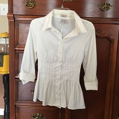Blouse off white Silky off white blouse. Ties in the back. Looks good with skirts or pants. Tops Blouses