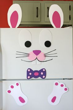 I used craft foam and card stock paper to turn our white refrigerator into an Easter bunny!  I didn't see anything like this on the internet, so I came up with my own design. ~ B. West