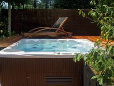 Perfection! A Beachcomber hot tub is the perfect place to relax in any weather, especially sun.
