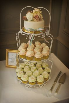 Vintage Inspired Cupcake Tower for an English Garden Party Wedding. Cupcakes topped with Ivory Fondant Roses.  www.restorationcake.co.uk