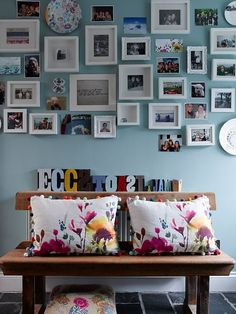 Photo wall. Love the colours