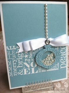 Card by Erika Clark (103111) [Stampin' Up! (e/f) Snowburst; (punch) Ornament Punch; (stamps) Jolly Jingles Jumbo Roller]