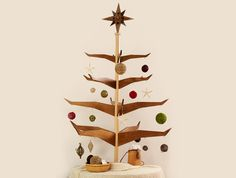 Scandinavian style melds old-world charm with modern lines to capture the magic of Nordic winter forests in motion with the People's Tree. Made of sustainable poplar this handcrafted piece of decor will make a beautiful and eco-friendly addition to any home. + Available at Festive Tree for $350.00