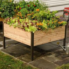 Elevated Cedar Planter Box. www.teeliesfairygarden.com . . . This elevated cedar planter box is just lovely! All nature and gardening enthusiasts will surely love to have this in their garden! #fairyplanter