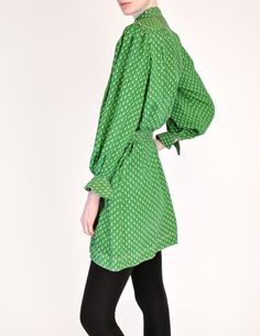 """Jean Muir Vintage Green Geometric Button Up Tunic Dress - from Amarcord Vintage Fashion.Jean Muir London, 1970s, Green Geometric Button Up Tunic Dress - from Amarcord Vintage Fashion. """"Vivid green silk w/ grey geometric pattern throughout. Sitch details along collar, shoulders, and cuffs. Plastic button up front with matching fabric belt, lucite buckle. Pockets at hips."""" 100% silk. Priced at $795.00. Sold."""