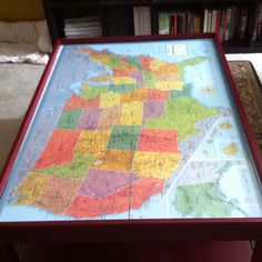 $30 used train table, $5 can of spray paint, $5 map, and $10 sheet of plexi glass transformed the shabby train table into a chic multi purpose table for my boys.