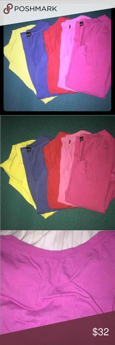 Lot of 5 colorful v neck tees Perfect for summer! Bright colors. You get 5 v neck shirts  Price is firm since such a great deal.  This is very thin material. Cute for summer!  Light and airy. :)   Colors are:  Lime green or yellowish  Blue  Red Light pink  Dark pink   ****the only flaw on these are on ONE shirt which is barely even noticeable. Such a tiny hole you see in 2nd pic.*****  GREAT CONDITION! Will sell for $25 on merc with $4 shipping Wet Seal Tops Tees - Short Sleeve