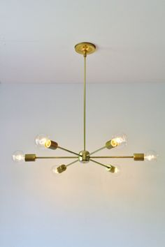Modern Brass Chandelier, Mid Century Starburst Sputnik Chandelier Lighting Fixture, 6 Arms & Sockets, BootsNGus Lighting and Home Decor by BootsNGus on Etsy https://www.etsy.com/listing/243375508/modern-brass-chandelier-mid-century