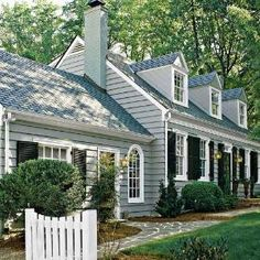 grey blue house. I want black shutters. I dont think we have space for black shutters though!