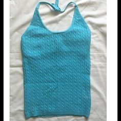 Blue Gap Cable Knit Halter Top Tiffany Blue Gap cable knit halter top. Ties around neck and has built in bralet. Size medium however runs small. Material: 97% cotton, 1% Lycra spandex, 2% other fiber GAP Tops