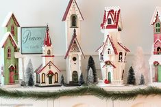 Come tour this Christmas dining with lots of natural and rustic touches and watery green and blues - coastal lake cottage Christmas at thehappyhousie.com-11