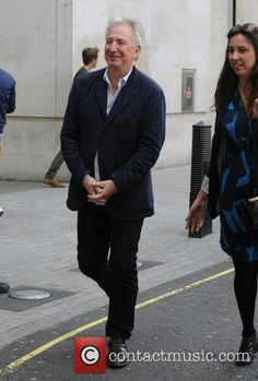 April 17, 2015 -- Alan Rickman Leaving the BBC Studios. I don't know who the lady is.