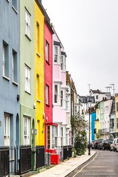 A pretty row of rainbow colored houses on Godfrey Street in Chelsea, London.  #london #chelsea #house #rainbow