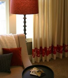 love the idea of dressing up plain curtains by sewing patterned strip of fabric at the bottom