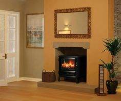 If you love the look of traditional black stoves, but want to benefit from electric heating, then here's a great looking stove that fits the bill perfectly. The Piermont stove… Wood Burning Stoves Uk, Wood, Stove, Dimplex, Oak Frame House, Fireplace Hearth, Fireplace, Living Room With Fireplace, Wood Stove