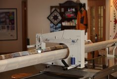 As a smaller version of APQS' legendary Millennium longarm quilting machine, Lenni features a precision stitch regulator and has everything you need to start your longarm experience.