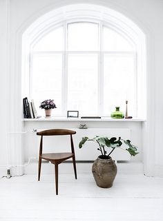 white living room with green plants