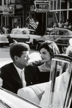 President Kennedy & Jacqueline...I love the way she's looking at him!