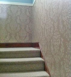 Is your hallway screaming for a makeover? Kathy spruced up her space with a Verde Damask stencil. Then she put a metallic paint glaze over the stencil and took a brush over it to create a striae effect. Great job!  Love it? Make it yours! http://www.cuttingedgestencils.com/damask-stencil-wallpaper.html  #cuttingedgestencils #stenciling #wallstencils #stencils
