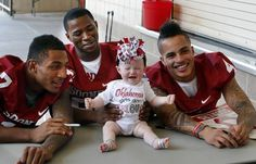 Wrigley Milkeraitis, 8 months, of Weathrerford, Okla. poses with receivers Trey Metoyer (17), Lacolton Bester (86) and Kenny Stills (4) during the Meet the Sooners event inside Gaylord Family/Oklahoma Memorial Stadium at the University of Oklahoma on Saturday, Aug. 4, 2012, in Norman, Okla.  Photo by Steve Sisney, The Oklahoman