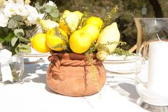 Lemon and Rosemary in Terracotta Post Italian Table Centrepiece Setting. By Cinque Terre Wedding: www.cinqueterrewedding.com