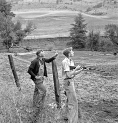 Farmer and boy in the fall of the year at the time the hunting season opens. They live in a white painted house across the road. Jackson County, Oregon, October 1939 Dorothea Lange photographer