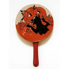 Halloween NoiseMaker (tin) by bindlegrim, via Flickr, love the cat sticking it's tongue out...lol